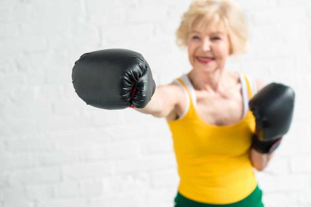Kvinna boxning äldre